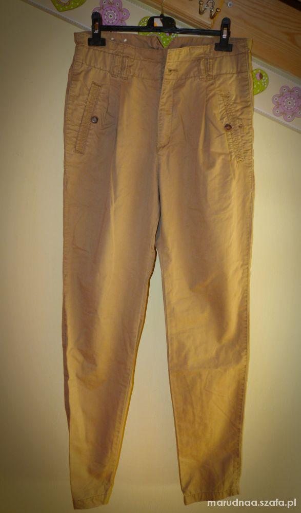 Spodnie bryczesy chinosy XS S brązowe khaki...
