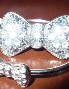 Pierścionek i bransoletka z kokardą H&M