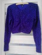 Fioletowy sweterek bolerko w panterkę