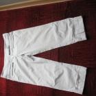 Białe spodnie z mankietem