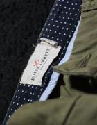 Spodnie oliwkowe Lindex...