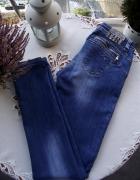 Świetne spodnie damskie jeansy Tommy Hilfiger S M
