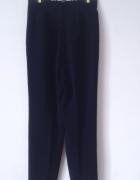 Granatowe spodnie eleganckie chinosy na kantkę