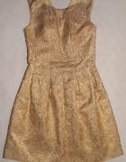 Złota sukienka rozkloszowana