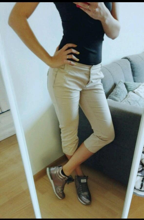 Spodnie kremowe Sisley