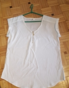 Sprzedam białą koszule z zamkiem z przodu...
