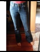 Dżinsowe spodnie szersze nogawki L 40...