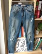 Spodnie jeansy vintage z dziurami Bershka rozmiar 36...