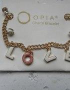 bransoletka z zawieszkami opia