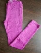 fioletowe fuksjowe spodnie rurki 146 cm...