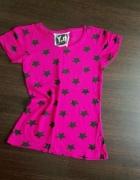 różowa bluzka w czarne gwiazdki...