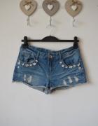 szorty jeans dziury kwiatki m...