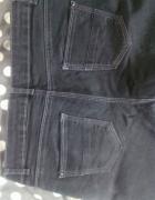 Czarne spodnie Camaieu...
