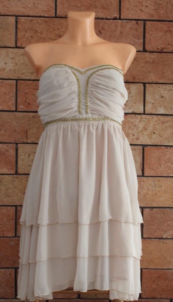 elegancka sukienka kremowa