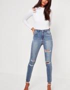 Spodnie dżinsowe jeansowe jeansy dżinsy niebieskie dziury przet...