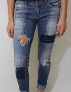 spodnie jeansowe z przetarciami s