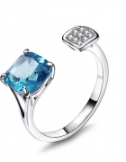 Nowy pierścionek z dużą niebieską cyrkonią otwarty srebrny kolor rodowany