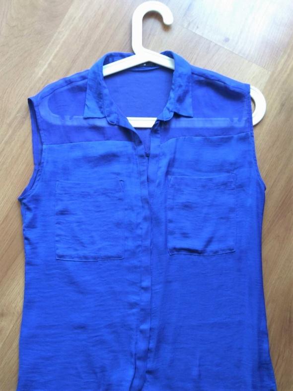 Koszula niebieska bez rękawów...