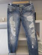 Fajne spodnie z rozdarciami jeansy nity...