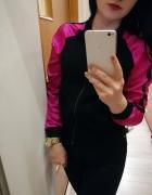 Czarna bluza różowe rękawy jak bomberka 36