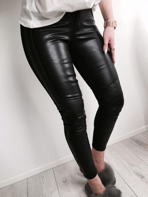 36 S Nowe skórzane skinny spodnie tył materiałowy