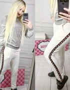 Białe spodnie dresowe z perełkami