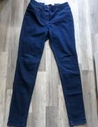 Granatowe jeansowe tregginsy 40 L...