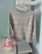 Sweter z dziurami pudrowy róż Primark...