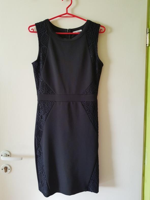 Elegancka sukienka granatowa...