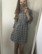 Sukienka w kratkę modna wiązana w tali