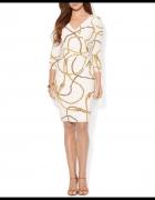 elegancka sukienka z motywem lancuchow