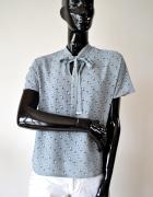 Nowa elegancka bluzka w koty wiązany dekold