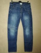 Niebieskie męskie jeansy z przeszyciami W31 L33