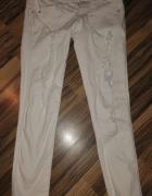 białe rurki dziury przetarcia jeans 34