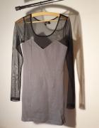 Krótka dopasowana sukienka z przezroczystą górą...