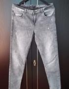 szare jeansy przetarcia