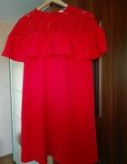Elegancka czerwona sukienka...