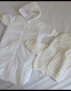 Biały śpiworek dla niemowlaka pasuje na rozmiar ok 68