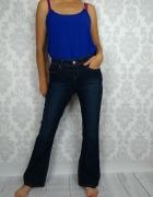 Ciemne spodnie jeansy dżinsy dzwony Bootcut