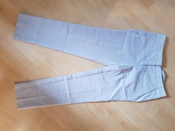 Beżowe eleganckie spodnie...