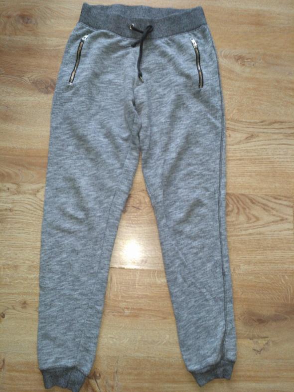 Szare spodnie na gumce 36