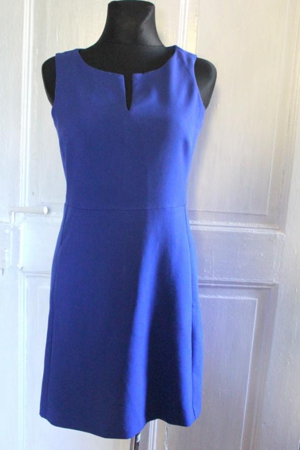 Kobaltowa elegancka sukienka z kieszeniami r M...