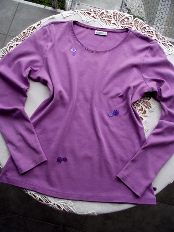 Urocza bluzka z dzianiny w liliowym kolorze...