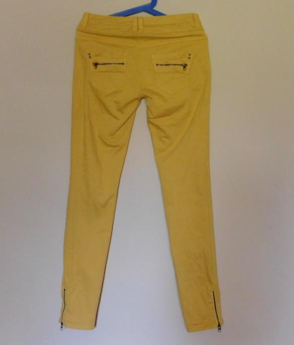 Esprit żółte spodnie skinny rurki 36...