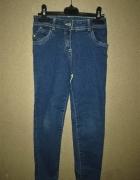 Elastyczne jeansy rurki wysoki stan 122 128 cm 7 8 lat...