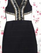 Czarna sukienka ze zdobieniami