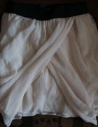 Powiększająca pupę spódniczka mini beżowa...