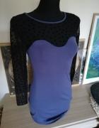 Nowa sukienka z efektownym dekoltem