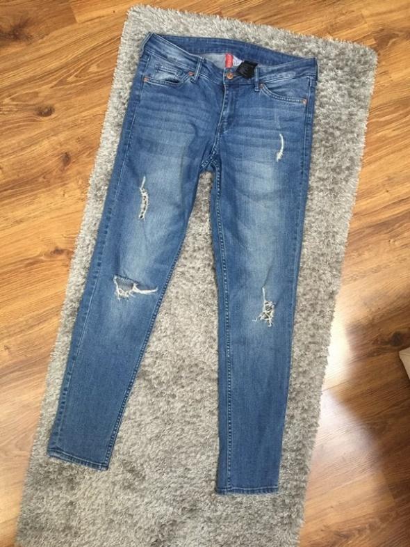 Spodnie jeansowe dziury L