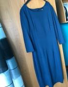 Turkusowa sukienka midi 34...